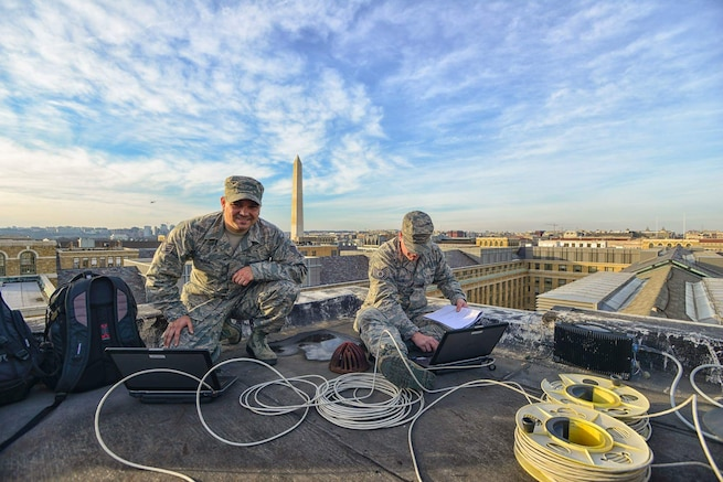 Staff Sgt. Anthony Baca, cyber support specialist, and Tech. Sgt. Bryan Scharman, noncommissioned officer in charge of cyber support; both with the Utah Air National Guard's 151st Communications Flight, set up communications between supported agencies during the 58th Presidential Inauguration. The Airmen were part of a 7,500 member team that supported civil authorities in Washington, D.C. (U.S. Air National Guard photo by Tech. Sgt. Jonathan Young)