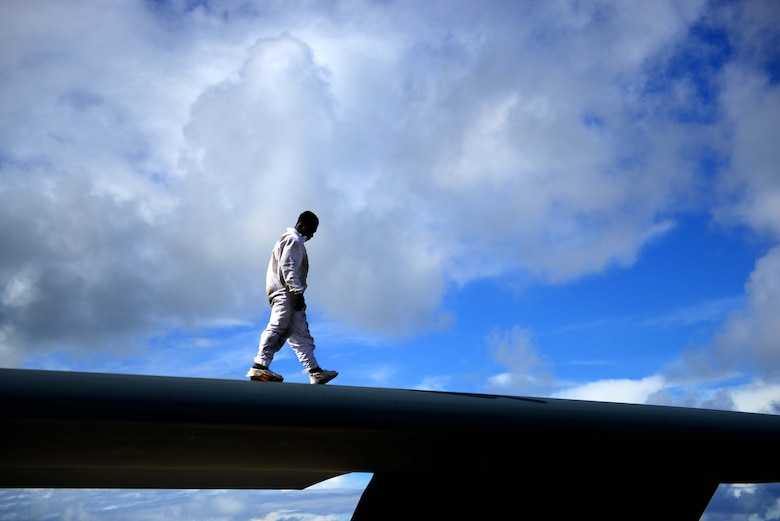 U.S. Air Force Staff Sgt. Elijah Fleming, a crew chief assigned to the 509th Aircraft Maintenance Squadron, walks on top of the B-2 Spirit aircraft while performing post-flight inspections after a local training at Andersen Air Force Base, Guam, Jan. 17, 2017. Close to 200 Airmen from Whiteman Air Force Base, Mo., and Barksdale Air Force Base, La., deployed to Andersen AFB, in support of U.S. Strategic Command Bomber and Deterrence missions. USSTRATCOM bomber missions familiarize aircrew with airbases and operations in different Geographic Combatant Commands. (U.S. Air Force photo by Tech Sgt. Andy M. Kin)
