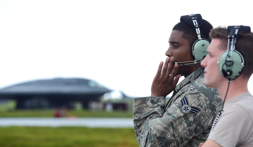 U.S. Air Force Senior Airman Dez Starkes (left) and Senior Airman Hayden Thayer, both crew chiefs assigned to the 509th Aircraft Maintenance Squadron, communicate pre-flight instructions with a B-2 Spirit pilot prior to takeoff at Andersen Air Force Base, Guam, Jan. 12, 2017. U.S. Strategic Command (USSTRATCOM) units regularly conduct training with and in support of the Geographic Combatant Commands. USSTRATCOM, through its global strike assets, helps maintain global stability and security while enabling units to become familiar with operations in different regions. (U.S. Air Force photo by Airman 1st Class Jazmin Smith)