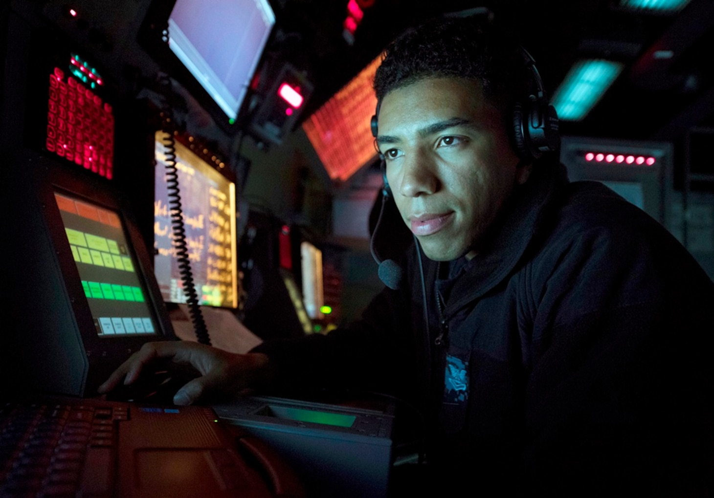IMAGE: 170130-N-PP996-057 (Jan. 30, 2017) Cryptologic Technician (Technical) 2nd Class Jonathan Morel, from Salem, Massachusetts, uses a radar tracking system to track surface contacts aboard Arleigh Burke-class guided-missile destroyer USS Michael Murphy (DDG 112). Michael Murphy is on a regularly scheduled Western Pacific deployment with the Carl Vinson Carrier Strike Group as part of the U.S. Pacific Fleet-led initiative to extend the command and control functions of U.S. 3rd Fleet. U.S. Navy aircraft carrier strike groups have patrolled the Indo-Asia-Pacific regularly and routinely for more than 70 years. (U.S. Navy photo by Mass Communication Specialist 3rd Class Danny Kelley/Released)