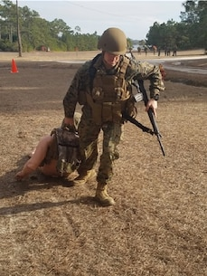 On January 17, 2017, Second Lieutenant Mitchell Bottini performs the Ground Casualty Evacuation portion of the MOS Specific Physical Standards (MSPS) evaluation.  This is one of five MSPS events and it is a 50-meter movement which simulates moving from a covered and concealed position to a casualty's position and dragging that casualty out of direct fire to a safe position.