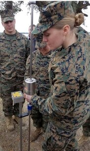 On January 5, 2017, Marines attached to Combat Engineer Officer course 2-17 (CEO 2-17) conduct a soils stabilization test.  CEO students learn how to analyze soil stability and incorporate the results into their planning process for construction.  Pictured from left to right are Second Lieutenants Chase Alexanian, Beth Park, and Margo Darragh.