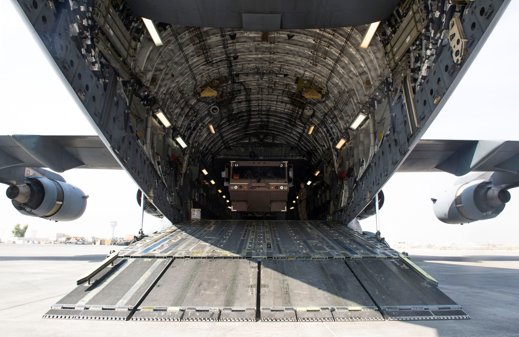 An 870th Air Expeditionary Advisory Squadron Airman drives a fire engine out of an 816th Expeditionary Airlift Squadron C-17 Globemaster III during a mission in support of Combined Joint Task Force - Operation Inherent Resolve Oct. 25, 2016. The 816th EAS delivered fire engines to Iraq. The squadrons are actively engaged in tactical airlift operations supporting the Mosul offensive. (U.S. Air Force photo by Staff Sgt. Matthew B. Fredericks)