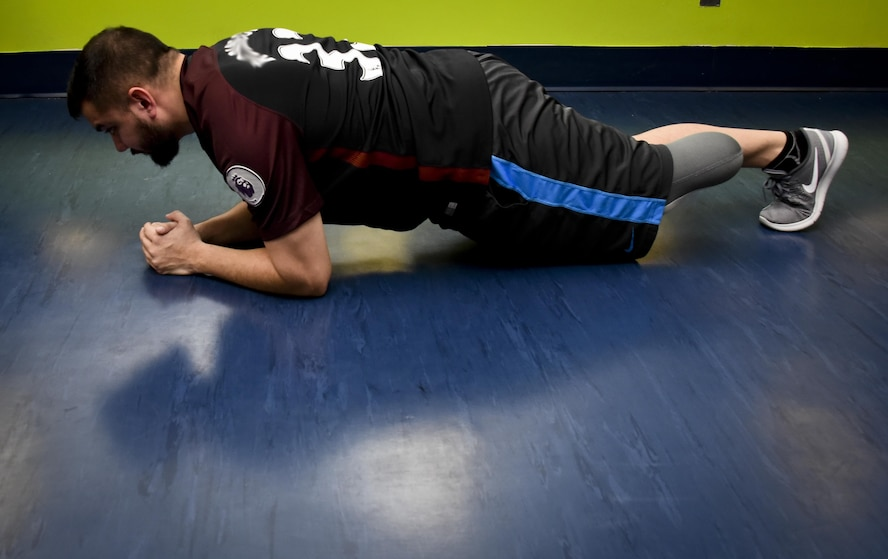 Staff Sgt. Chuck, 32nd Intelligence Squadron, 70th Intelligence, Surveillance and Reconnaissance Wing, performs a plank exercise January 30, 2017 at the Gaffney Fitness Center on Fort George G. Meade. Chuck had his left leg amputated in November 2016 when he found he had the disease called Pseudomyogenic Hemangioendothelioma of Bone. (U.S. Air Force photo/Staff Sgt. AJ Hyatt)