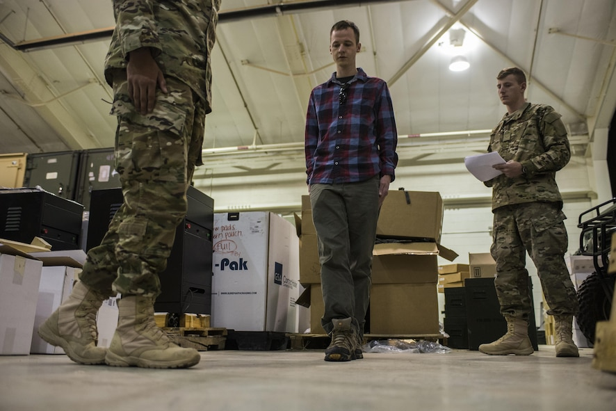 A participant, middle, attempts to walk a straight line during Standardized Field Sobriety Test training for 27th Special Operations Security Forces Squadron members Jan. 25, 2017, at Cannon Air Force Base, N.M. The officers had the volunteers perform as series of tasks testing motor skills like balancing on one foot and walking in a straight line while simultaneously assessing their mental sharpness with concise counting and answering of questions. (U.S. Air Force photo by Senior Airman Luke Kitterman/Released)