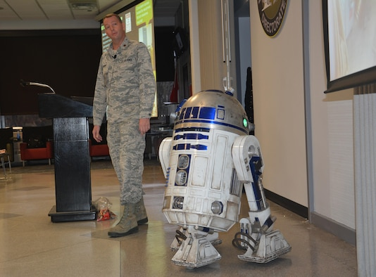 Maj. James Enderby, joined by R2-D2, served as emcee and coordinator for the Materials and Manufacturing Directorate's Star Wars-themed Safety Down Day.  The annual event encourages personnel to observe and refresh themselves on proper safety protocol.  (U.S. Air Force photo/David Dixon)