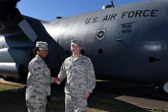 U.S. Air Force Col. Charles Brown, 19th Airlift Wing commander, congratulates U.S. Air Force Senior Airman Brianna Ruiz-Garcia, 19th Communications Squadron command support staff, as the Combat Airlifter of the Week Jan. 30, 2017, at Little Rock Air Force Base, Ark. (U.S. Air Force photo by Airman Kevin Sommer)