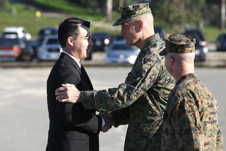 Sgt. Zachary L. Piepenhagen (left), shakes hands with Maj. Gen. David Coffman, deputy commanding general, I Marine Expeditionary Force, after being awarded the Navy and Marine Corps Medal, at Marine Corps Base Camp Pendleton, Calif., Jan. 26, 2017. Piepenhagen was awarded the medal for saving the life of a distressed Sailor who climbed over the guard rail in an attempt to commit suicide while serving with the 13th Marine Expeditionary Unit. (U.S. Marine Corps photo by Private First Class Gabino Perez)