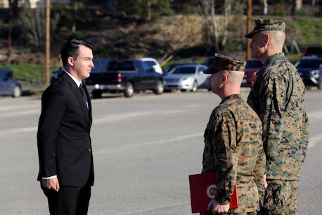 Sgt. Zachary L. Piepenhagen (left), stands at attention as Maj. Gen. David Coffman (right), deputy commanding general, I Marine Expeditionary Force, awards him the Navy and Marine Corps Medal, at Marine Corps Base Camp Pendleton, Calif., Jan. 26, 2017. Piepenhagen was awarded the medal for saving the life of a distressed Sailor who climbed over the guard rail in an attempt to commit suicide while serving with the 13th Marine Expeditionary Unit. (U.S. Marine Corps photo by Private First Class Gabino Perez)