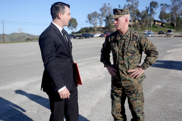 Sgt. Zachary L. Piepenhagen (left), talks to Sgt. Maj. Bradley Kasal, sergeant major, I Marine Expeditionary Force, after being awarded the Navy and Marine Corps Medal, at Marine Corps Base Camp Pendleton, Calif., Jan. 26, 2017. Piepenhagen was awarded the medal for saving the life of a distressed Sailor who climbed over the guard rail in an attempt to commit suicide while serving with the 13th Marine Expeditionary Unit. (U.S. Marine Corps photo by Private First Class Gabino Perez)