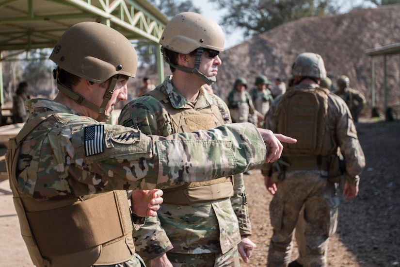 U.S. Army Sgt. 1st Class Carson Headley, and U.S. Army Sgt. 1st Class Russell Shields, Office of Security Cooperation Iraq senior-enlisted advisors, Security Sector Reform Group, discuss their observations of Nineva Police weapons training Jan. 24, 2017, Camp Taji, Iraq. Combined Joint Task Force – Operation Inherent Resolve, aims to enable and equip local forces to defeat ISIL in Iraq.  (U.S. Army photo by Spc. Derrik Tribbey)