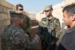 Command Sgt. Maj. Benjamin Jones, senior-enlisted leader, Combined Joint Task Force – Operation Inherent Resolve, discusses training with Iraqi army Lt. Hager Haider, Iraqi Ranger instructor, Jan. 23, 2017, Camp Taji, Iraq. Training at building partner capacity sites is an integral part of Combined Joint Task Force – Operation Inherent Resolve's global Coalition effort to train Iraqi security forces personnel to defeat ISIL.  (U.S. Army photo by Spc. Derrik Tribbey)