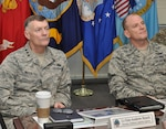 Defense Logistics Agency Director Air Force Lt. Gen. Andy Busch and DLA Energy Commander Air Force Brig. Gen. Martin Chapin listen to a briefing during the DLA Energy's Annual Operating Plan Review at the McNamara Headquarters Complex, Fort Belvoir, Jan. 30.