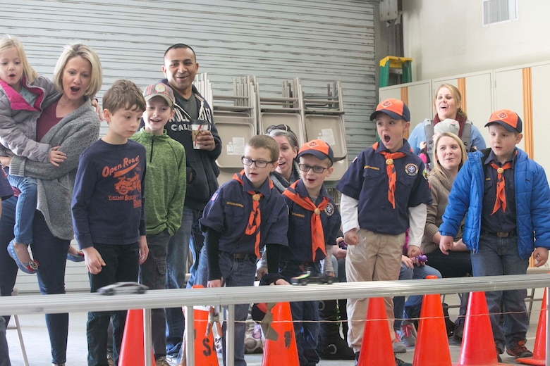 Children with Cub Scout Pack 78 cheer as their race cars pass the finish line during the annual Cub Scout Pinewood Derby at the Armed Services YMCA Scout Hut, Jan. 21, 2017. (U.S. Marine Corps photo by Cpl. Thomas Mudd)