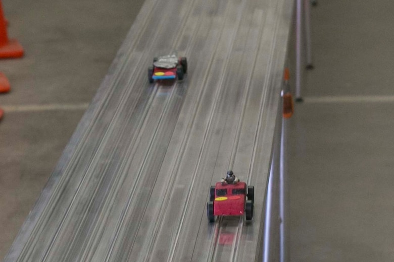 Pinewood Derby cars race down the track during the annual Cub Scout Pinewood Derby at the Armed Services YMCA Scout Hut, Jan. 21, 2017. (U.S. Marine Corps photo by Cpl. Thomas Mudd)