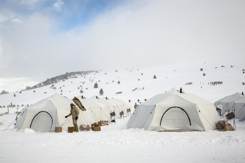 """Marines with 2nd Battalion, 2nd Marine Regiment, inhabit Artic Tents at a tent city located in Grouse Meadows training area during Mountain Training Exercise 1-17 in the vicinity of the Marine Corps Mountain Warfare Training Center Bridgeport, Calif., Jan, 18, 2016. MCMWTC is one of the Marine Corps' most secluded posts, comprised of approximately 46,000 acres of terrain with elevations ranging from 5,000 to 11,000 feet. During this iteration of MTX, the inclusion of the Artic Tent, designed to house up to 15 personnel, enabled the """"Warlords"""" to be truly immersed in the frigid landscape throughout the full duration of the training. (U.S. Marine Corps photo by Cpl. Levi Schultz)"""