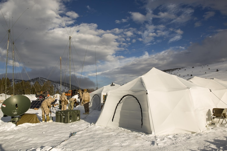 """Marines with 2nd Battalion, 2nd Marine Regiment, set up communication equipment in a tent city located in the Grouse Meadows training area during Mountain Training Exercise 1-17 in the vicinity of the Marine Corps Mountain Warfare Training Center Bridgeport, Calif., Jan, 18, 2016. MCMWTC is one of the Marine Corps' most secluded posts, comprised of approximately 46,000 acres of terrain with elevations ranging from 5,000 to 11,000 feet. During this iteration of MTX, the inclusion of the Artic Tent, designed to house up to 15 personnel, enabled the """"Warlords"""" to be truly immersed in the frigid landscape throughout the full duration of the training. (U.S. Marine Corps photo by Cpl. Levi Schultz)"""