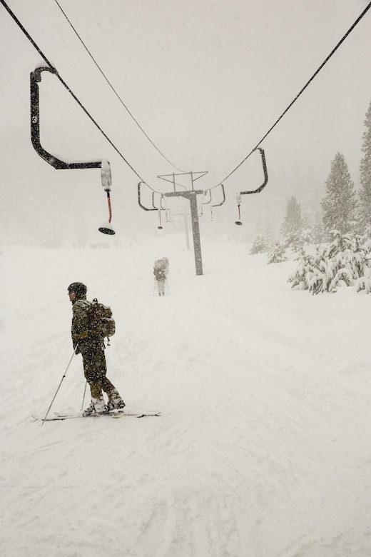 Cpl. Austin Smith, rifleman, 2nd Battalion, 2nd Marine Regiment, rests at the bottom of a ski lift while conducting ski drills during Mountain Training Exercise 1-17 in the Marine Corps Mountain Warfare Training Center Bridgeport, Calif., training area Jan. 19, 2016. MCMWTC is one of the Marine Corps' most secluded posts, comprised of approximately 46,000 acres of terrain with elevations ranging from 5,000 to 11,000 feet. The exercise trains elements of the Marine air-ground task force across the warfighting functions for operations in mountainous, high-altitude and cold-weather environments in order to enhance a unit's ability to shoot, move, communicate, sustain and survive in the most rugged regions of the world. (U.S. Marine Corps photo by Cpl. Levi Schultz)