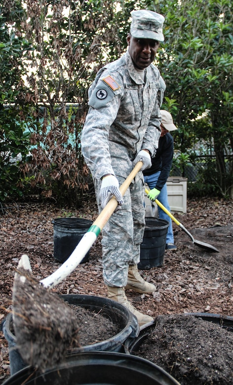 Army Warrant Officer 3 Fred L. Hemphill, a Montgomery, Ala., native serving as a property book officer, Headquarters and Headquarters Company, 143d Sustainment Command (Expeditionary), digs out old soil to make space for fresh soil during a an environmental sustainability community project Jan. 27, 2017, in Orlando, Fla. Torres and six other Army Reserve Soldiers joined scores of volunteers from the Orlando community to help bring Colonialtown North Community Garden back to its former, greener glory. Directed by Green Works Orlando in conjunction with the National Football League's Environmental Program, the garden's revival was one of the many community projects both organizations managed to lighten the environmental footprint produced by the tens of thousands of football fans who have flocked to The City Beautiful to watch the NFL's first Pro Bowl game to take place in Florida since 1977.