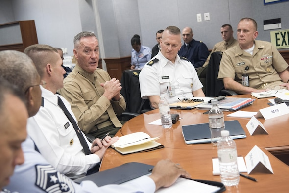 Marine Corps Gen. Joe Dunford, chairman of the Joint Chiefs of Staff, speaks with Army Command Sgt. Maj. John Troxell, the senior enlisted advisor to the chairman, and senior enlisted leaders from across the Defense Department during the Defense Senior Enlisted Leaders Council at the Pentagon, Dec. 1, 2016. DoD photo by Navy Petty Officer 2nd Class Dominique A. Pineiro