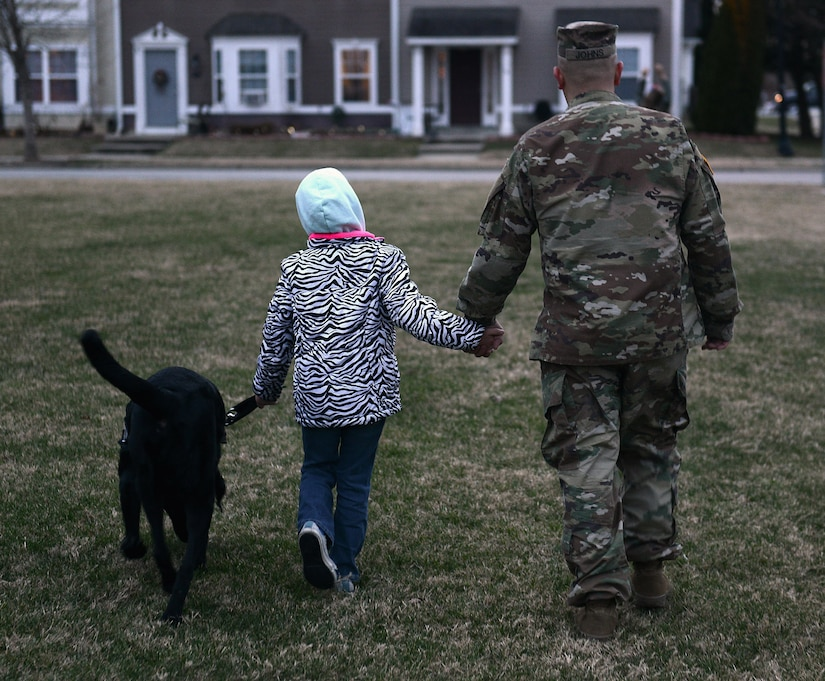 U.S. Army Sgt. Matthew Johns, 221st Military Police Detachment military police officer, and his daughter AudreeAna, age six, walk her service dog, Hope, at Joint Base Langley-Eustis, Va., Jan. 5, 2017. Before arriving to JBLE due to a permanent change of station, the Johns family worked with the Exceptional Family Member Program, a mandatory program for all active-duty service members with special needs family members. (U.S. Air Force photo by Staff Sgt. Teresa J. Cleveland)