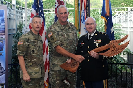 Gen. Robert B. Brown (center), commanding officer, U.S. Army Pacific, and Sgt. Maj. Christopher S. Richardson (left), Command Career Counselor, USARPAC, presents Sgt. 1st Class Chad Emrick, a U.S. Army Reserve Component Career Counselor, the USARPAC Reserve Component Career Counselor of the Year award. Emrick earned the award during USARPAC's annual career counselor competition that consists of the Army physical fitness test, written exam, and a board appearance.