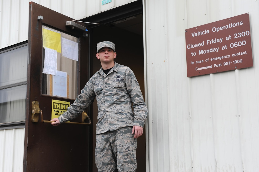 U.S. Air Force Senior Airman Anthony Feist, 19th Logistics Readiness Squadron Vehicle Operations shop operator dispatcher, departs the shop for a vehicle inspection Jan. 12, 2017, at Little Rock Air Force Base, Ark. The Vehicle Operations shop caters to the ground transportation needs of the base by providing 61 vehicles, such as sedans, vans, tow trucks and other vehicles. (U.S. Air Force photo by Airman 1st Class Grace Nichols)