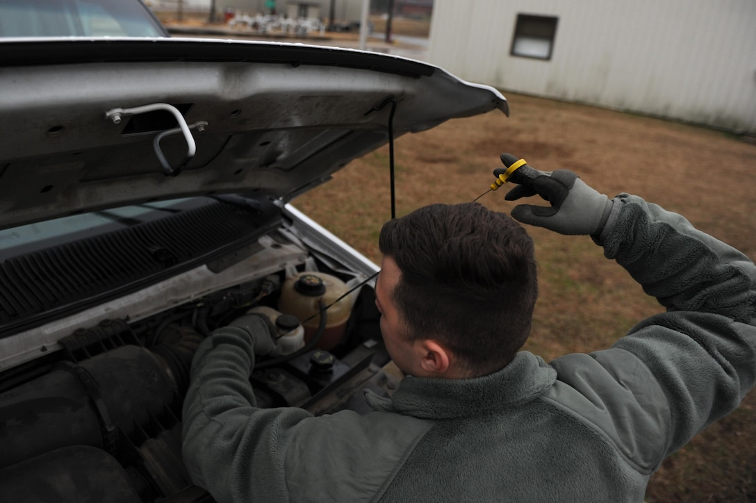 U.S. Air Force Airman 1st Class Vinson Mixon, 19th Logistics Readiness Squadron Vehicle Operations shop operator and dispatcher, checks fluid levels in a vehicle Jan. 12, 2017, at Little Rock Air Force Base, Ark. Every vehicle under the care of the Vehicle Operations shop is inspected every seven days to ensure it's operating at optimum efficiency. (U.S. Air Force photo by Airman 1st Class Grace Nichols)