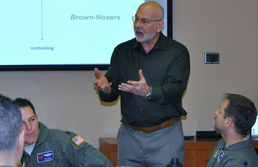 Dr. Gordon Curphy, leadership expert, briefs 39th Flying Training Squadron leadership at the JBSA-Randolph Parr Officer's Club, Jan. 18, during a forum that took an in-depth look into squadron mission and leadership practices in the 39th FTS. (Photo by Janis El Shabazz)