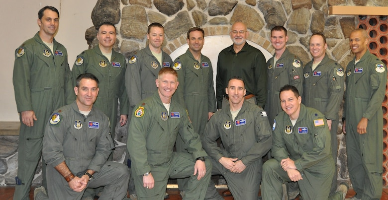 Dr. Gordon Curphy, leadership expert (center), poses for a group photo with 39th Flying Training Squadron leadership at the JBSA-Randolph Parr Officer's Club, Jan. 18, after his presentation to the group. (Photo by Janis El Shabazz)