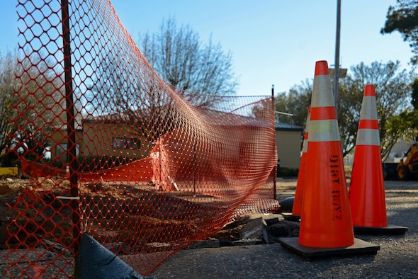 Cones and a safety fence surround a construction area at a developing fire station project at Shaw Air Force Base, S.C., Jan. 25, 2017. The project includes expanding the parking lot and renovating the interior of an existing building to accommodate five 20th Civil Engineer Squadron firefighters.