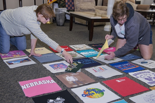 "Gold Star Family members lay out T-shirt quilt panels Jan. 24, 2017, at Joint Base San Antonio-Fort Sam Houston. The term ""Gold Star"" describes a family member who has lost a loved one in military service and is a tradition that began during World War I. (U.S. Air Force photo by Senior Airman Stormy Archer)"