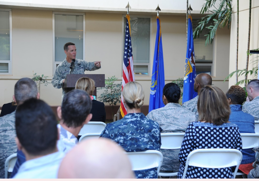 Col. Kevin Gordon, 15th Wing commander, acknowledges the importance of total force cooperation when it comes to military suicide at Joint Base Pearl Harbor-Hickam, Hawaii, Jan. 30, 2017. The 15th Wing mental health clinic was recognized for its superior efforts to prevent suicide in Sept. 2016 by the Defense Suicide Prevention Office. (U.S. Air Force photo by 1st Lt. Kaitlin Daddona/Released)