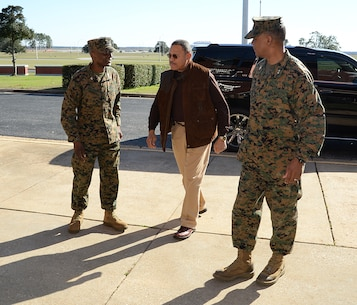 Col. James C. Carroll (left) commanding officer, Marine Corps Logistics Base Albany, and Maj. Gen. Craig C. Crenshaw (right) commanding general, Marine Corps Logistics Command, meet with Sanford D. Bishop, Jr., U.S. Representative for Georgia's 2nd congressional district, to discuss the tornado's destruction and cleanup efforts, Jan. 25. A line of strong thunderstorms produced a tornado that passed through the Albany, Georgia, community and Marine Corps Logistics Base Albany carving a path of destruction leaving the landscape strewn with broken trees, downed power lines and damaged structures, Jan. 22.