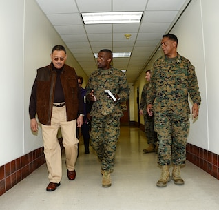 Col. James C. Carroll (center) commanding officer, Marine Corps Logistics Base Albany, explains the impact of the tornado to Sanford D. Bishop, Jr., U.S. Representative for Georgia's 2nd congressional district, during a tour of the installation while Maj. Gen. Craig C. Crenshaw, commanding general, Marine Corps Logistics Command, looks on, Jan. 25.