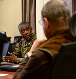 Col. James C. Carroll, commanding officer, Marine Corps Logistics Base Albany, updates Sanford D. Bishop, Jr., U.S. Representative for Georgia's 2nd congressional district, on the tornado's destruction and clean up efforts taking place aboard the installation, Jan. 25.