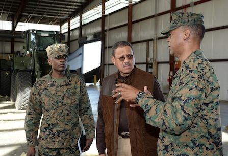 Maj. Gen. Craig C. Crenshaw (far right) commanding general, Marine Corps Logistics Command, explains the impact of the tornado to Sanford D. Bishop, Jr., U.S. Representative for Georgia's 2nd congressional district, during a tour of the installation while Col. James C. Carroll, commanding officer, Marine Corps Logistics Base Albany, looks on, Jan. 25.
