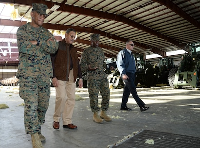 Col. James C. Carroll, commanding officer, Marine Corps Logistics Base Albany, explains the impact of the tornado to Sanford D. Bishop, Jr., U.S. Representative for Georgia's 2nd congressional district, during a tour of the installation with Maj. Gen. Craig C. Crenshaw (far left), commanding general, Marine Corps Logistics Command, and Kent Morrison (far right) executive director, MCLB Albany, Jan. 25.