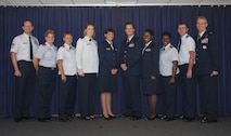 Graduates from the Tampa Nurse Transition Program pause for a photo with MacDill Air Force Base, Fla., leadership at Tampa General Hospital, Jan. 26, 2017. The goal of the program is to ease the transition of novice and inexperienced nurses to competent active duty nurses. (U.S. Air Force photo by Airman 1st Class Mariette Adams)
