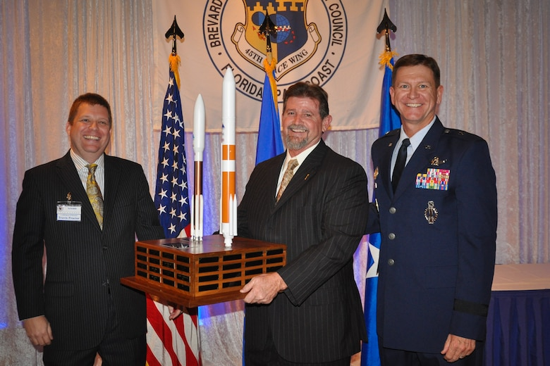 Travis Proctor, CivMil Chairman of the Board, left, and Brig. Gen. Wayne Monteith, 45th Space Wing commander, right, present John Baker, senior project manager for Millennium Engineering & Integration Company, with the CivMil Member of the Year Award Jan. 21, 2017, at Patrick Air Force Base, Fla. Baker was selected as CivMil Member of the Year for his selfless donation of time and leadership in securing volunteers to ensure successful community events. (U.S. Air Force photo by 1st Lt. Amanda Herman)