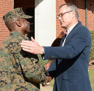 Col. James C. Carroll III, commanding officer, Marine Corps Logistics Base Albany, greets Georgia's Lieutenant Governor Casey Cagle during a recent visit, Jan. 27.