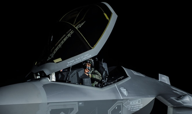 """A pilot assigned to the 388th Fighter Wing, Hill Air Force Base, Utah, performs preflight checks in an F-35A Lightning II before a night operation Red Flag 17-1 on Nellis Air Force Base, Nev., Jan. 24, 2017. Aircraft and personnel deploy to Nellis AFB for Red Flag under the Air Expeditionary Force concept and make up the exercise's """"Blue"""" forces. (U.S. Air Force photo by Airman 1st Class Kevin Tanenbaum/Released)"""