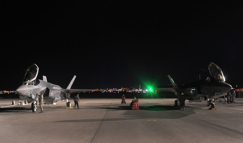 Maintainers assigned to the 419th and 388th Fighter Wings, Hill Air Force Base, Utah, prepare two F-35A Lightning II aircraft to participate in Red Flag 17-1 night operations on Nellis Air Force Base, Nev., Jan. 24, 2017. Night missions have been integrated into Red Flag to prepare aircrews for missions in low-light environments. (U.S. Air Force photo by Airman 1st Class Kevin Tanenbaum/Released)