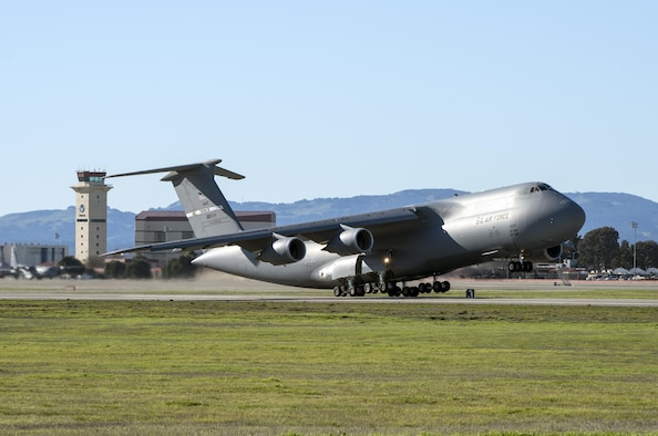 A C-5M Super Galaxy takes off at Travis Air Force Base, Calif., Jan. 13, 2017. Aircrews fly the new M-model around the world supporting Department of Defense missions with improved capabilities such as fuel efficiency, reduced noise and greater payloads. The Travis AFB mission provides Rapid Global Mobility quickly and decisively to locations all around the globe. (U.S. Air Force photo/ Heide Couch)