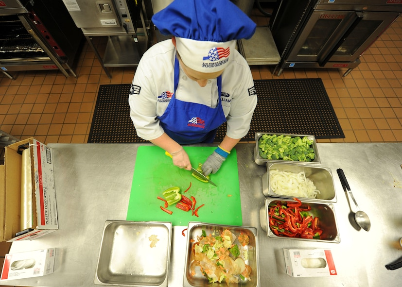 Senior Airman Amanda Williams, a food service journeyman assigned to the 28th Force Support Squadron prepares fresh vegetables for the lunch rush at Ellsworth Air Force Base, S.D., Oct. 6, 2016. Ellsworth recently became the Air Force Global Strike Command finalist for the John L. Hennessy award, which recognizes the best dining facility in the Air Force. (U.S. Air Force photo by Airman 1st Class Randahl J. Jenson)