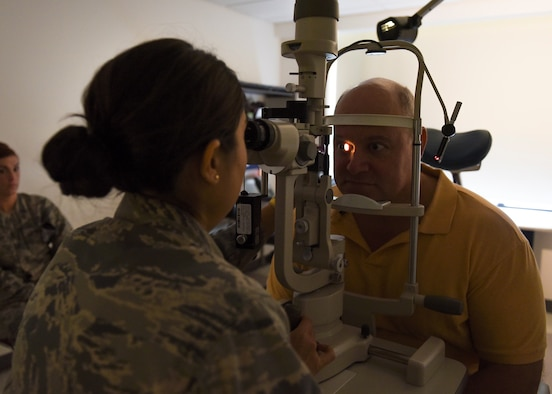 U.S. Air Force Capt. Michelle Massey, 325th Aerospace Medicine Squadron optometrist, performs an eye exam on Michael Scofield during a checkup at the 325th Medical Group Clinic on Tyndall Air Force Base, Fla., Jan. 25, 2017. The clinic provides health care services to all of Team Tyndall, as well as local retirees and dependents. (U.S. Air Force photo by Senior Airman Dustin Mullen/Released)