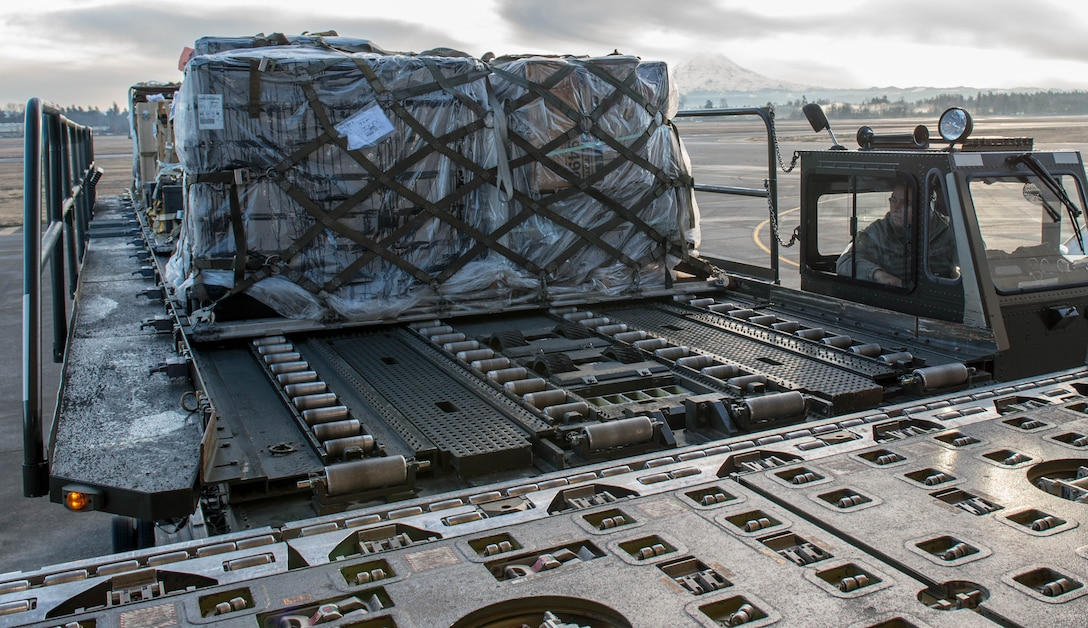 Staff Sgt. Jorge Hernandez, 821st Contingency Response Squadron, uses a K-loader to load cargo onto a KC-10 Extender aircraft from Travis Air Force Base, Calif., Jan. 23, 2017, at Joint Base Lewis-McChord, Washington. Airmen from the 821st Contingency Response Group, exercised their capability to support humanitarian efforts during exercise Dragon Breath at JBLM and Fairchild Air Force Base. (U.S. Air Force photo by Staff Sgt. Robert Hicks)