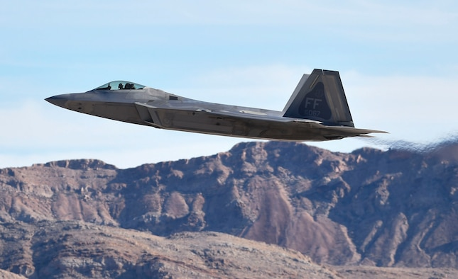 An F-22 Raptor from the 1st Fighter Wing out of Joint Base Langley-Eustis, Va., takes off during Red Flag 17-1 at Nellis Air Force Base, Nev., Jan. 26, 2017. The Raptors among other aircraft were cleared to fly after verifying several aspects of flight safety including weather. (U.S. Air Force photo by Staff Sgt. Natasha Stannard)