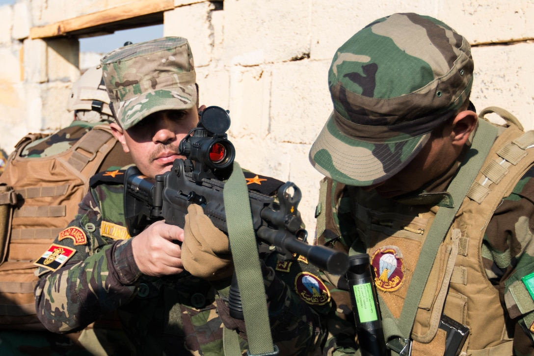 Iraqi army Lt. Hager Haider, Iraqi ranger instructor, coaches an Iraqi ranger trainee Jan. 23, 2017, on Camp Taji, Iraq. The training was part of Combined Joint Task Force Operation Inherent Resolve's mission to increase the effectiveness of Iraqi forces fighting the Islamic State of Iraq and Syria. Army photo by Spc. Derrik Tribbey