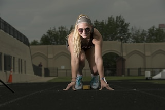 Army Staff Sgt. Megan Grudzinski poses for a photo in the starting blocks during practice for the 2017 Department of Defense Warrior Games in Chicago, June 30, 2017. DoD photo by EJ Hersom